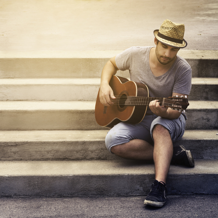 Photo for Man playing guitar on the street - Royalty Free Image