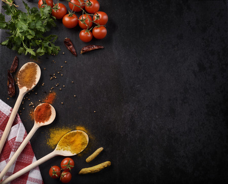 Photo for Various spices on rustic black background with copyspace. - Royalty Free Image