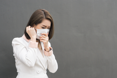 Photo for Asian woman wear protective face mask in pollution city with coughing., copy space for text - Royalty Free Image