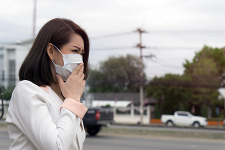 Photo for Woman suffer from sick and wearing face mask., asian woman in protective mask feeling bad on the street in the city with air pollution. - Royalty Free Image
