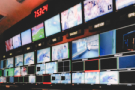 Foto de Blur image video switch of Television Broadcast, working with video and audio mixer, control broadcasts in recording studio. - Imagen libre de derechos