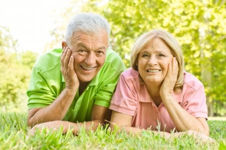 Foto de Portrait of happy old people relaxed in nature. - Imagen libre de derechos