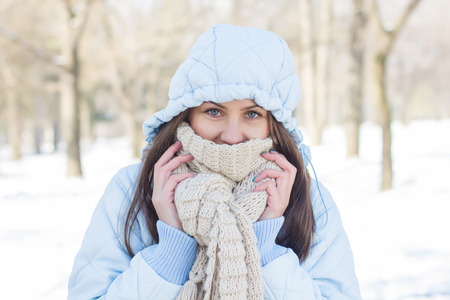 Foto de Winter Portrait of Young Woman wearing clothing for cold weather at snow day - Imagen libre de derechos
