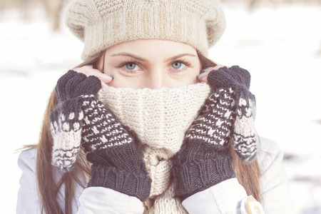 Foto de Winter Portrait of Female with Beautiful Blue Eyes outdoor - Imagen libre de derechos