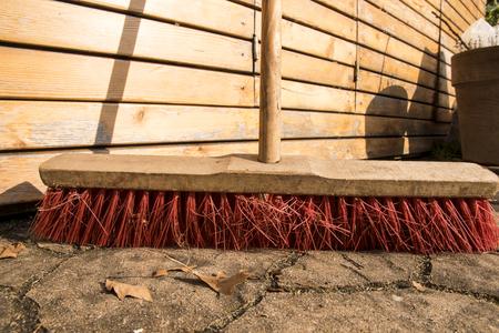 Foto de a red street broom on the sones - Imagen libre de derechos