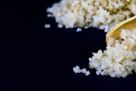Photo for wooden spoon with raw salt - Royalty Free Image