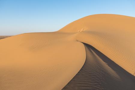 sand dunes in the desert Dasht-e Kavir at sunset in Iran