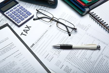 Foto de office work and filling in tax returns close up - Imagen libre de derechos