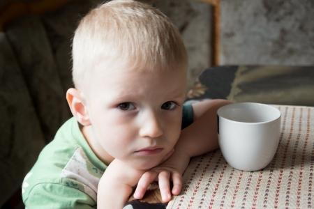 Foto de Sad upset tired worried little child (boy) close up portrait - Imagen libre de derechos