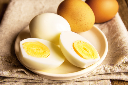 Foto de Boiled eggs over rustic linen and wooden background - Imagen libre de derechos