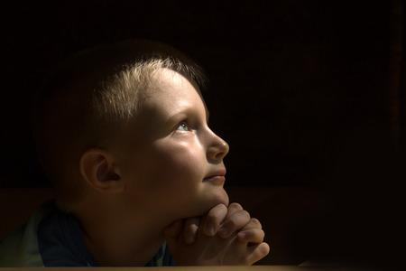 Photo pour Little young beautiful boy (child, kid) spiritual peaceful praying and wishing, horizontal, copy space. - image libre de droit