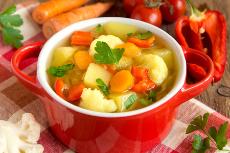 Vegetable soup with ingredients carrot cauliflower potato parsley pepper cabbage tomato close up