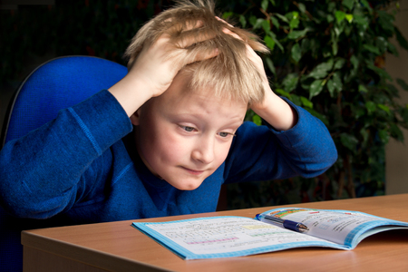 Photo for Tired boring boy don't want to do his difficult school homework - Royalty Free Image