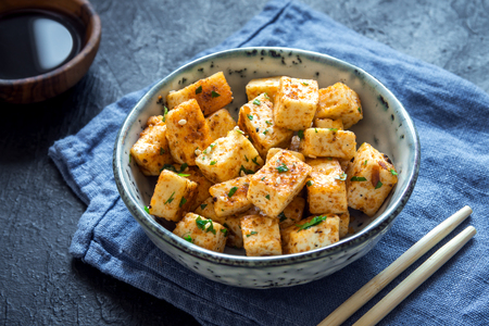 Photo for Stir Fried Tofu in a bowl with sesame and greens. Homemade healthy vegan asian meal - fried tofu. - Royalty Free Image