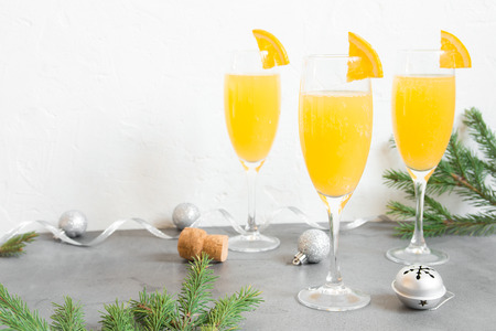 Photo for Mimosa festive drink for Christmas - Champagne cocktail Mimosa with Orange juice for Christmas party, copy space - Royalty Free Image