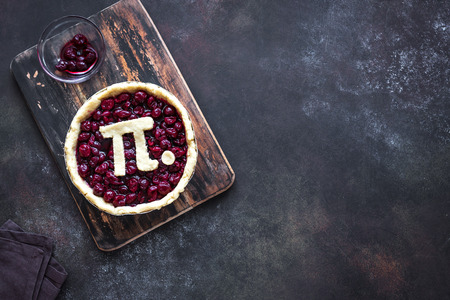 Photo for Pi Day Cherry Pie - making homemade traditional Cherry Pie with Pi sign for March 14th holiday, on rustic background, top view, copy space. - Royalty Free Image