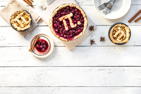 Photo for Pi Day Cherry and Apple Pies - homemade traditional various Pies with Pi sign for March 14th holiday, on white wooden background, top view, copy space. - Royalty Free Image