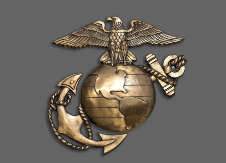 Photo pour Marine eagle,globe and anchor brass emblem. - image libre de droit