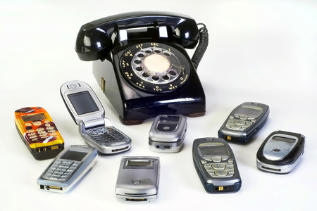 Photo pour Old working cell phones and black rotary telephone. - image libre de droit