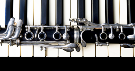 Photo for Closeup of a clarinet and keyboard. - Royalty Free Image