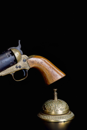 Photo pour Need service now, ringing service bell and cowboy pistol with room for your type, - image libre de droit
