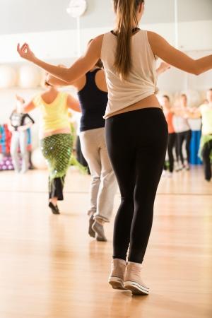Photo pour Dance class for women at fitness centre - image libre de droit