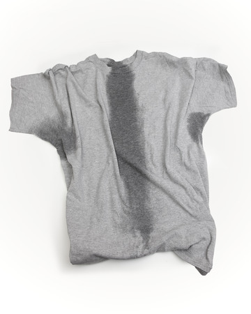 Photo pour A grey t-shirt with sweat stains under sleeves and through the torso. - image libre de droit