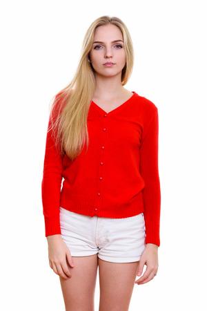 Foto de Studio shot of young beautiful teenage girl standing - Imagen libre de derechos