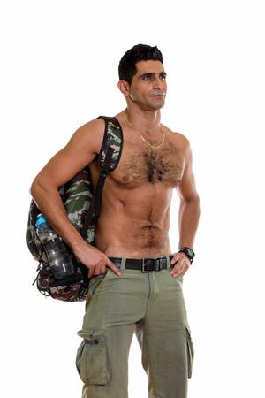 Foto de Studio shot of young muscular Persian man standing and thinking - Imagen libre de derechos