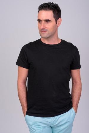 Photo pour Portrait of handsome man against white - image libre de droit