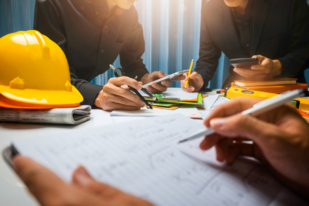Photo for Teamwork of business man contractor working meeting in the office construction site on their architect project. - Royalty Free Image