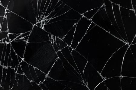 Foto de Top view cracked broken mobile screen glass texture background. - Imagen libre de derechos