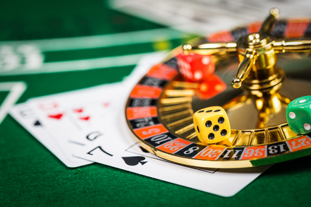 Photo pour Vintage casino chips on green table with game cards. - image libre de droit