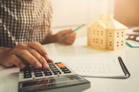 Photo for Young business man doing calculator finance cost in home office workplace. - Royalty Free Image