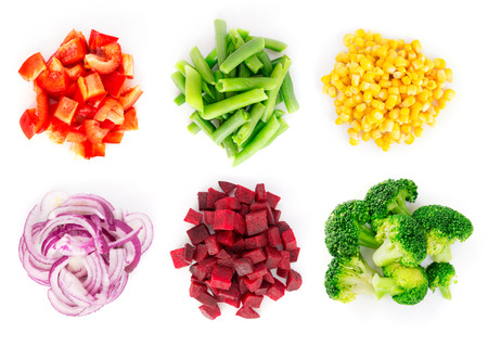 Photo pour Heaps of different cut vegetables isolated on white background. Top view. - image libre de droit