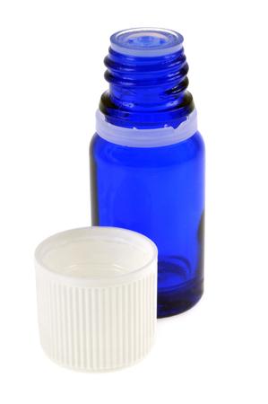 Photo pour Blue glass bottle on a white background - image libre de droit