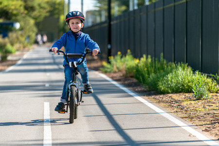 Photo for Happy aussie boy riding his bicycle on bike lane on a day, South Australia - Royalty Free Image