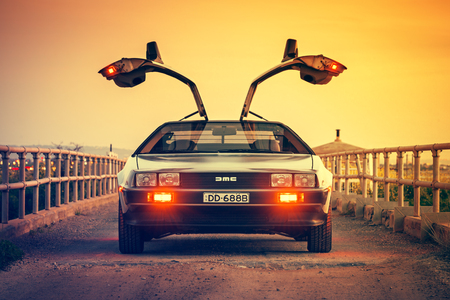 Photo pour Adelaide, Australia - September 7, 2013: DeLorean DMC-12 car with opened gullwing doors parked on the bridge at dusk - image libre de droit