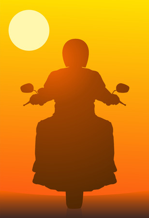 The motorcyclist against a red sunset