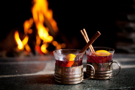 Photo for Mulled wine with cinnamon stick by the fireplace - Royalty Free Image