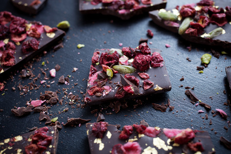 Photo for Handmade chocolate with berries, jpistachios and edible gold - Royalty Free Image