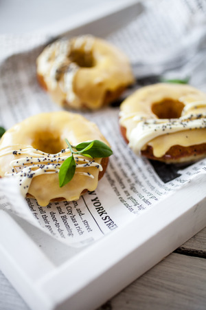 Photo for Lemon donuts with white chocolate and poppy seeds - Royalty Free Image