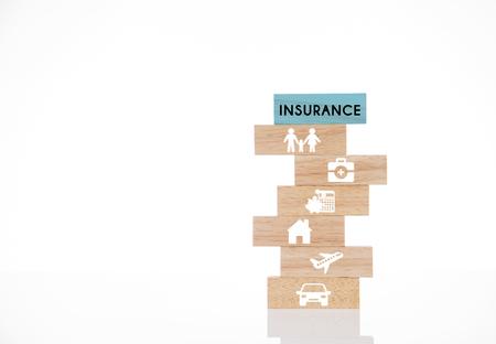 Foto de wooden blocks with insurance concept isolated on white background. - Imagen libre de derechos