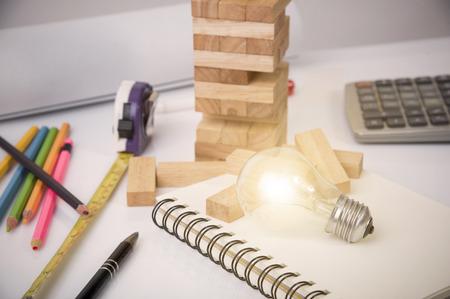 Photo pour light bulb on desk. brainstorming plan construction project concept. - image libre de droit