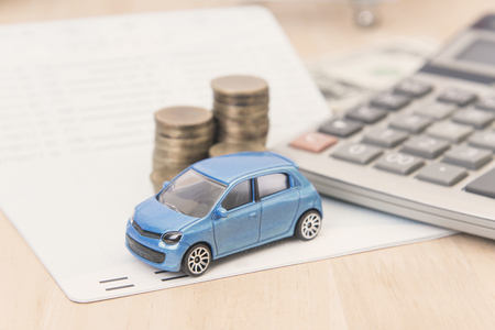 Photo for car with calculator and money on wood table. auto loan concept. - Royalty Free Image