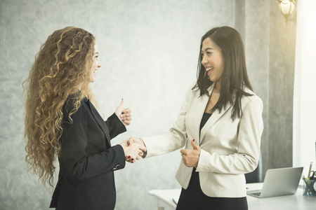 Photo for Businesswoman making handshake agreement in office. concept cooperation.  - Royalty Free Image