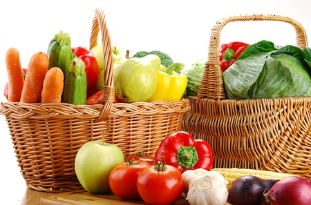 Composition with vegetables and wicker basket