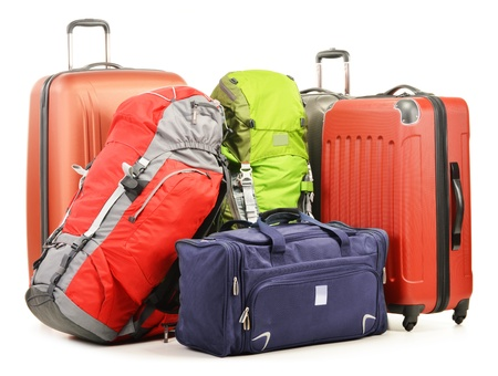 Foto de Luggage consisting of large suitcases rucksacks and travel bag isolated on white - Imagen libre de derechos