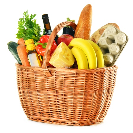 Photo pour Wicker basket with variety of grocery products isolated on white - image libre de droit