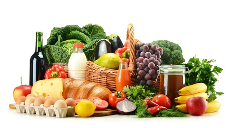 Grocery products including vegetables, fruits, dairy, bread and drinks isolated on white